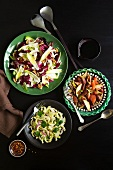 Assorted salads on a black background