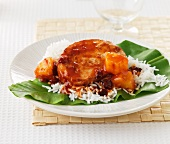 Sweet and sour pork with pineapple on a bed of rice