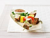 Chicken breast skewers with vegetables and mango, with peanut sauce