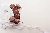 Chocolate macaroons with creamy almond filling