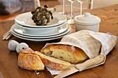 Fresh bread wrapped in a tea towel