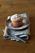 A muffin dusted with icing sugar