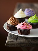 Cupcakes decorated with coloured frosting