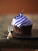 A cupcake decorated with lavender cream