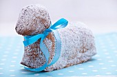 A sweet Easter lamb cake with a blue ribbon