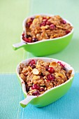 Individual cranberry crumble with almonds in pear-shaped dishes