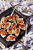 Barbecued oysters with tomatoes