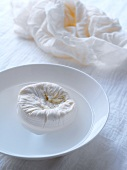 Home-made cream cheese wrapped in muslin