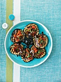 Barbecued aubergines with tomato salad and black olives