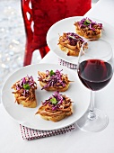 Crostini topped with pork and red cabbage