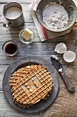 Homemade Pizzelles with Ingredients; Vanilla, Eggs, Butter Flour and Sugar; From Above