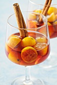 Kumquats in wine with cinnamon sticks