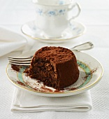 An individual dark chocolate torte