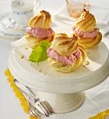Profiteroles with raspberry cream