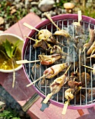 Mini squid skewers on the barbecue