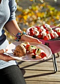 Barbecued strawberry and marshmallow skewers with chocolate ice cream