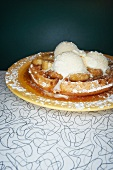 Banana Waffle Topped with Caramelized Bananas, Maple Syrup, Ice Cream and Powdered Sugar