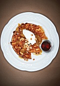 Hazelnut Waffle with Poached Fruit and Chopped Roasted Hazelnuts on a White Plate; Side of Maple Syrup