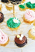 Assorted Spring Cupcakes on a Gold Wire Cupcake Holder