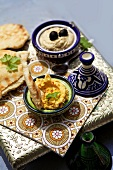 Houmous and sesame dips with pita bread
