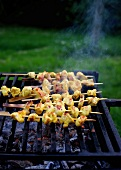 Oriental chicken kebabs on the barbecue