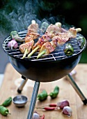 Chicken on lemon grass skewers on the barbecue