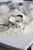 Flour, heart-shaped cutters and eggshells