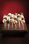 Assorted Cake Pops on a Wooden Stand