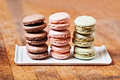 Three Stacks of Macaroons; Brown, Pink and Green