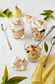 Pear Dessert Topped with Meringues in Glasses with Spoons