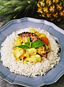Chicken curry with pineapple and dried apricots, on a bed of rice