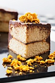 A chocolate-spread cake with crumbled pieces of honey cake