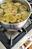 Artichokes boiling in water