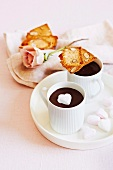 Hot chocolate with a marshmallow heart and biscotti for Valentine's Day