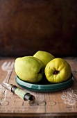 Three Quince on a Small Plate; Corer