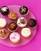 Assorted Cupcakes on a Pink Background