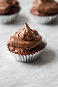 Mini Chocolate Cupcake with Chocolate Frosting in a Foil Wrapper