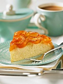 A slice of apricot upside-down cake