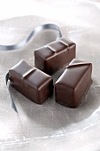 Three chocolate pralines