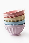 A stack of pastel-coloured bowls