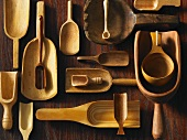 Assorted wooden scoops on a wooden surface