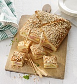 Stuffed party bread with an oat crust