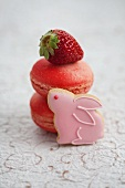 Strawberry macaroons, fresh strawberries and a rabbit-shaped biscuits