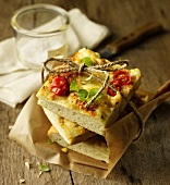 Focaccia (flatbread with herbs, tomatoes and cheese, Italy)