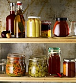 Jars of preserves on wooden shelves