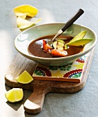 Mexican soup with avocado, tomato and courgette