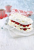 Coconut meringue cake with lime cream and raspberries