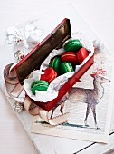 Green and red macaroons with chocolate and cinnamon cream