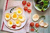 Fried quail's eggs in puff pastry shells with cherry tomatoes