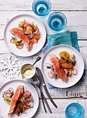 Poached salmon with an orange and radish salad
